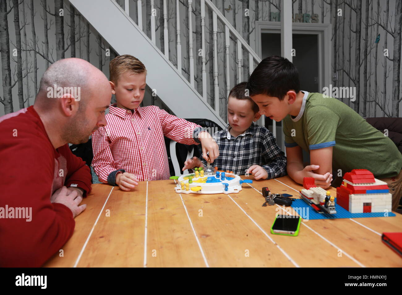 Family playing board games - Stock Image