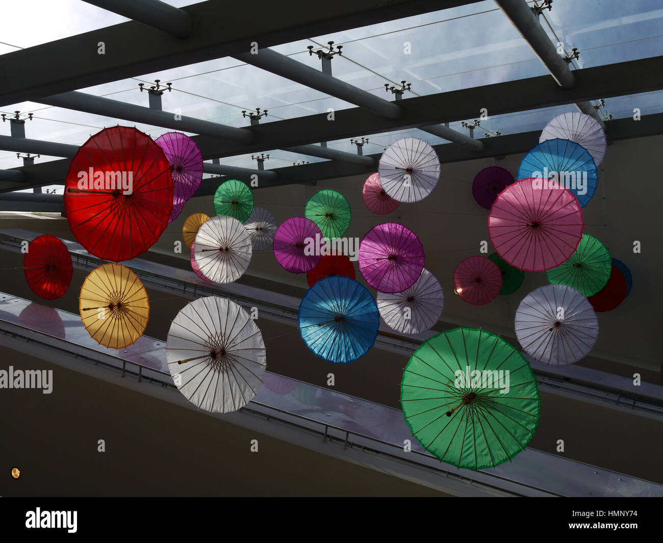 Colored parasols suspended from the ceiling of a mall in the Flushing section of New York City, in the borough of - Stock Image