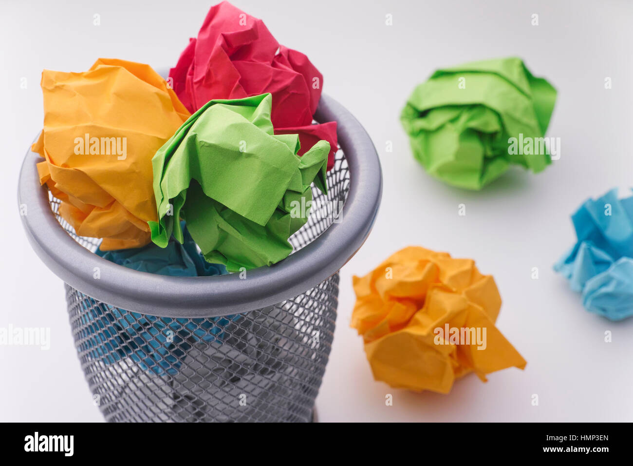 Colorful paper balls in a trash can. Idea Concept. - Stock Image