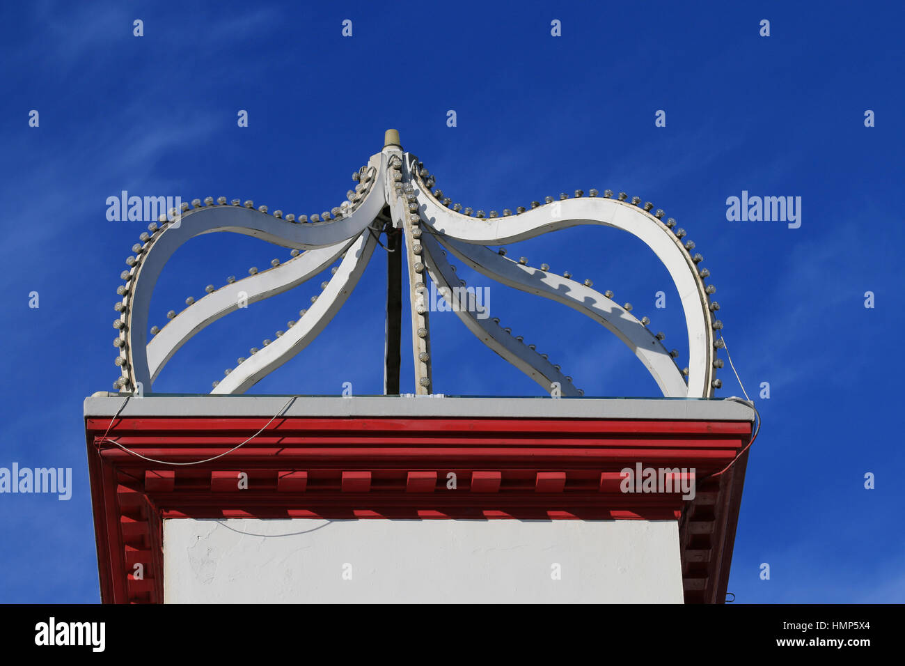 Architectural feature formed of curves atop an amusement arcade - Stock Image