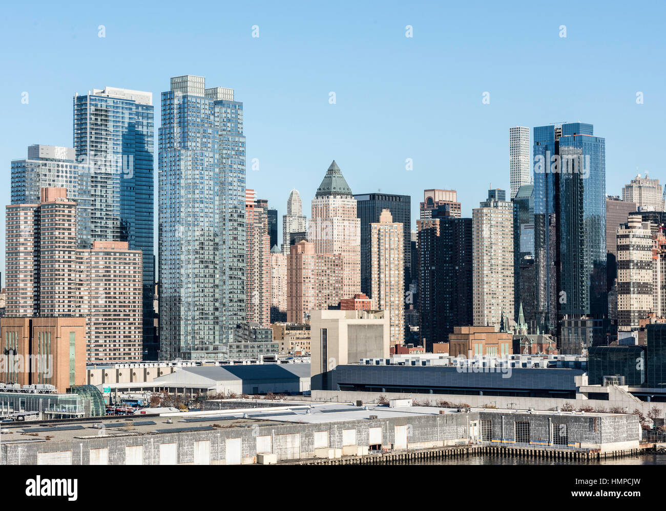 View of New York City Buildings from the harbor of the Hudson River. With high skyscrapers over looking the harbor. Stock Photo