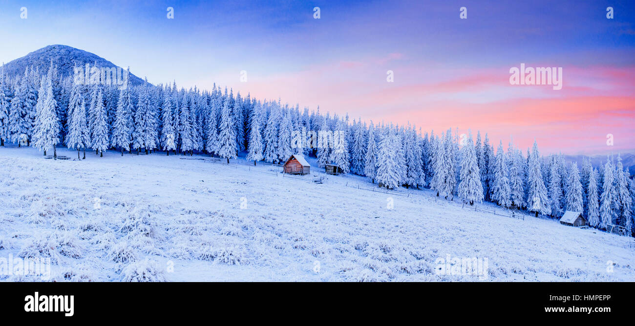 cabin in the mountains in winter - Stock Image