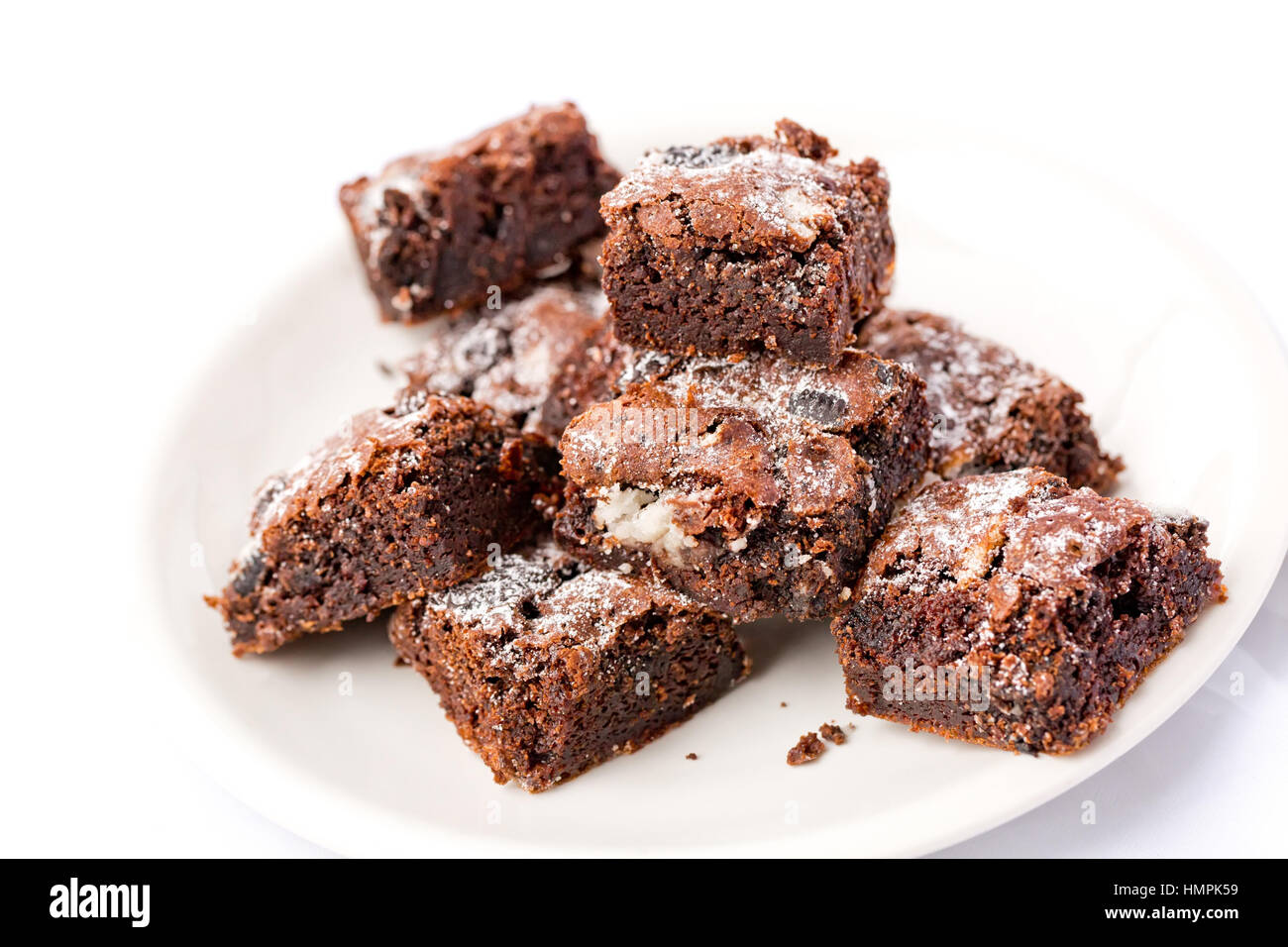 Delicious Freshly baked homemade cookies and cream brownie pieces on a white plate. Selective focus on the top of - Stock Image
