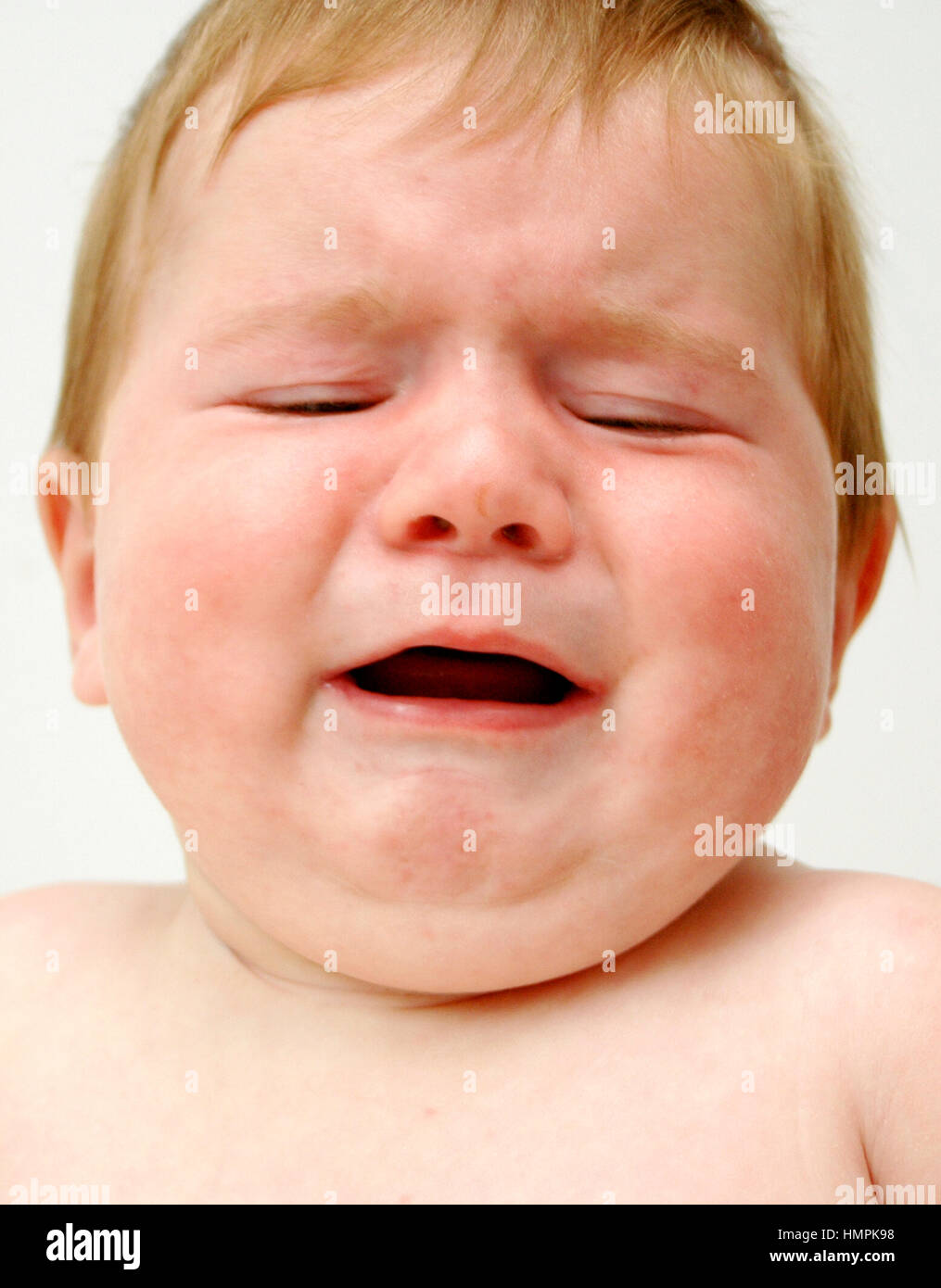7 month old baby crying Stock Photo