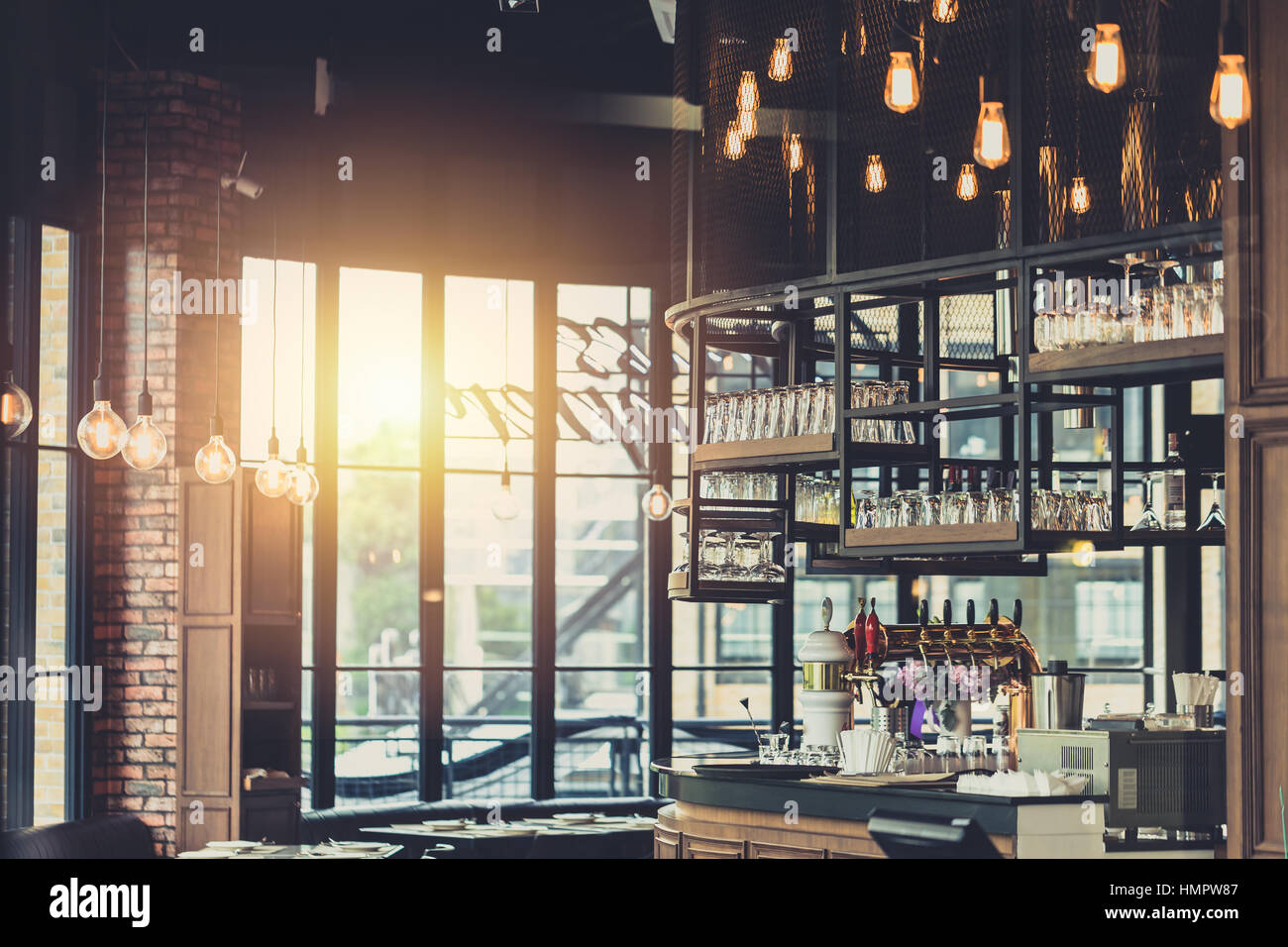 modern loft style restaurant decoration with hanging light bulb beer stock photo 133268471 alamy. Black Bedroom Furniture Sets. Home Design Ideas