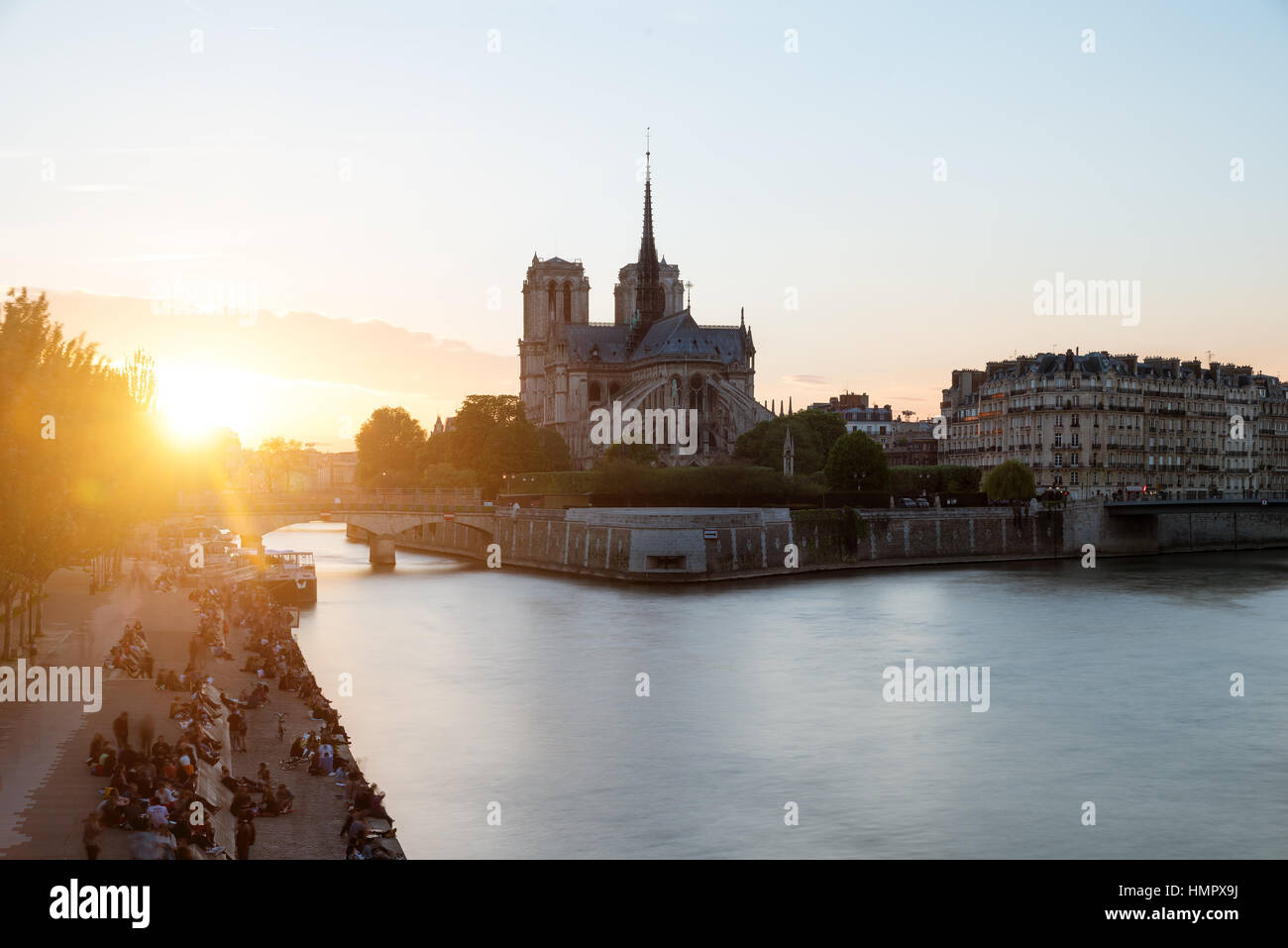 Cathedral of Notre Dame de Paris with Seine river at sunset. Paris, France. - Stock Image
