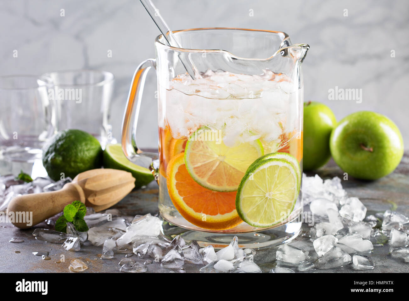 Infused water with citrus fruits in a pitcher Stock Photo