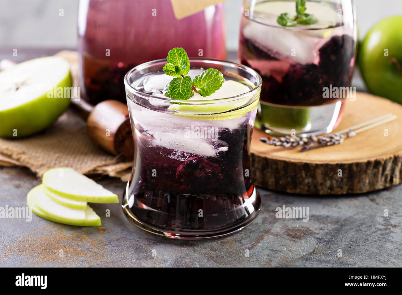 Refreshing cocktail with blackberry, lavender and apple - Stock Image