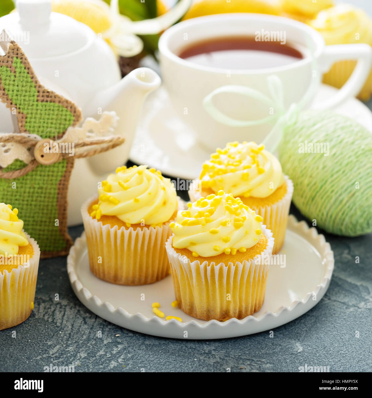 Lemon cupcakes with yellow frosting for Easter - Stock Image