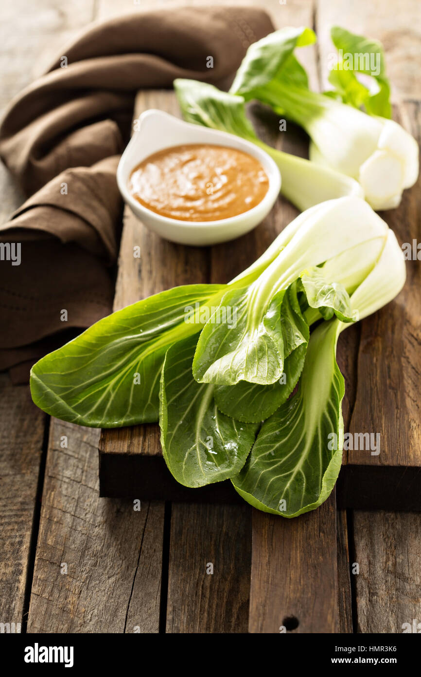 Baby bok choy with peanut spicy sauce - Stock Image