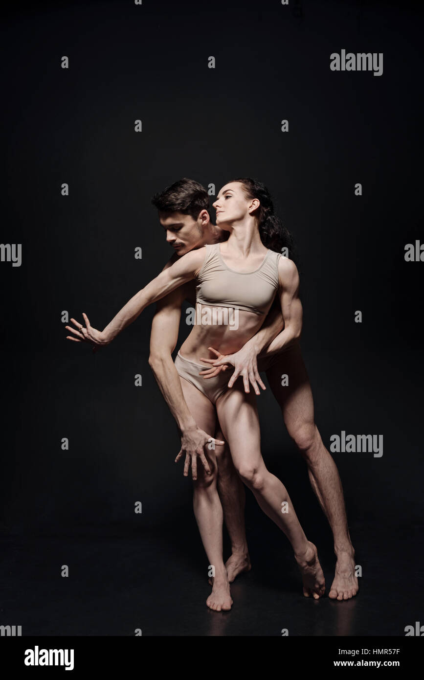 Skilled young ballet dancers performing together in the studio - Stock Image