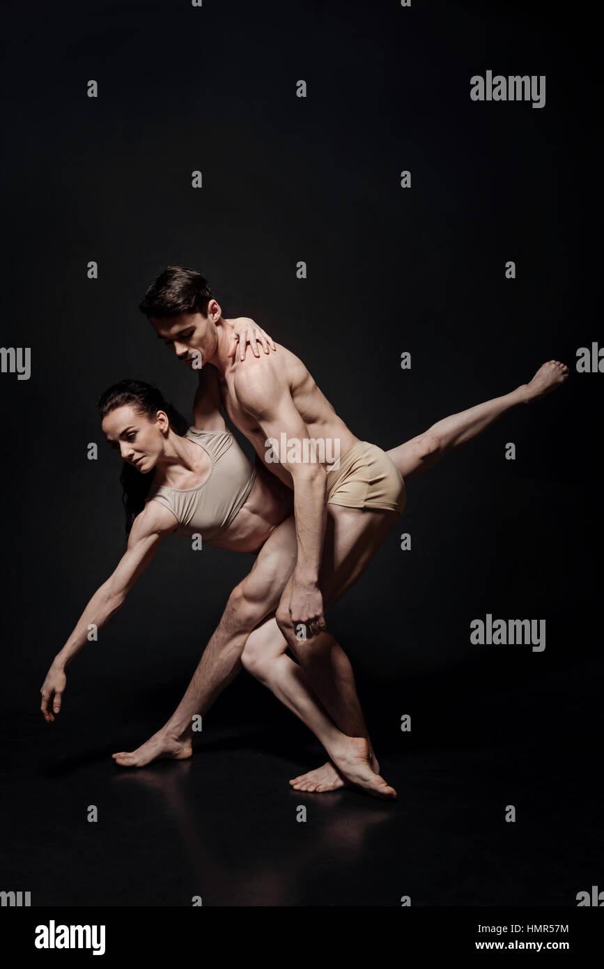 Graceful ballet dancers performing in the studio - Stock Image