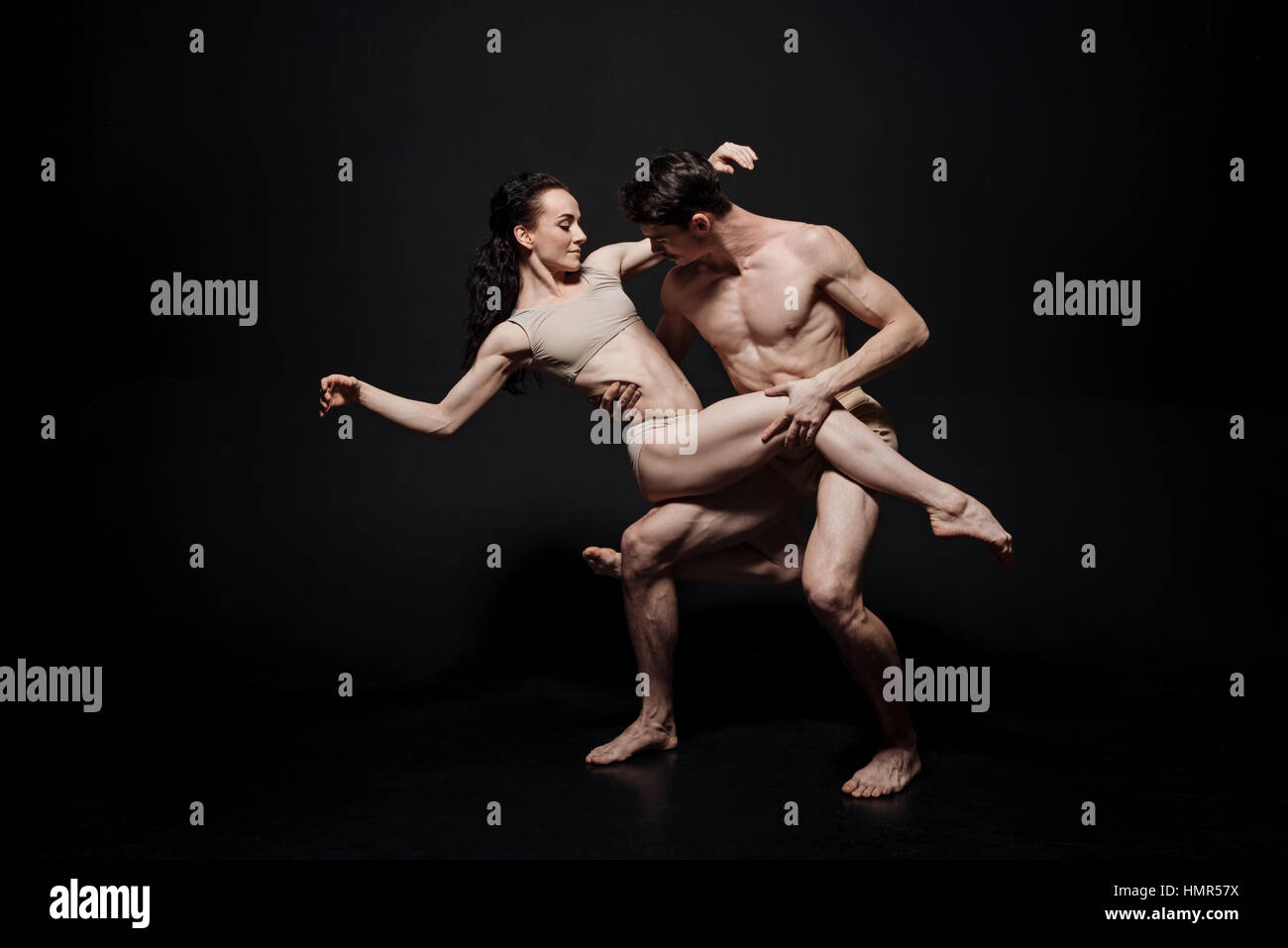 Delighted ballet dancers acting in the studio - Stock Image