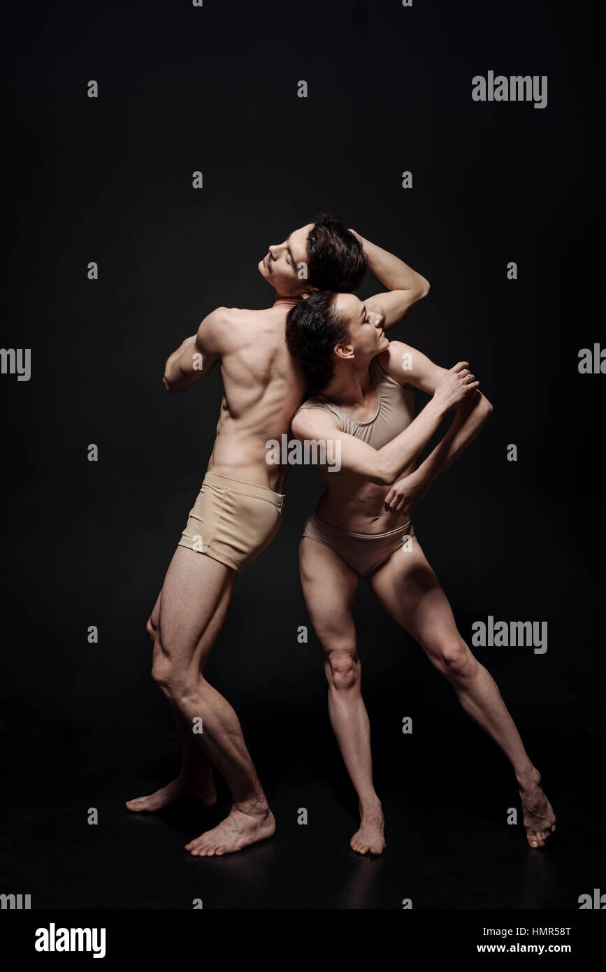 Inventive dance couple taking part in the art performance - Stock Image