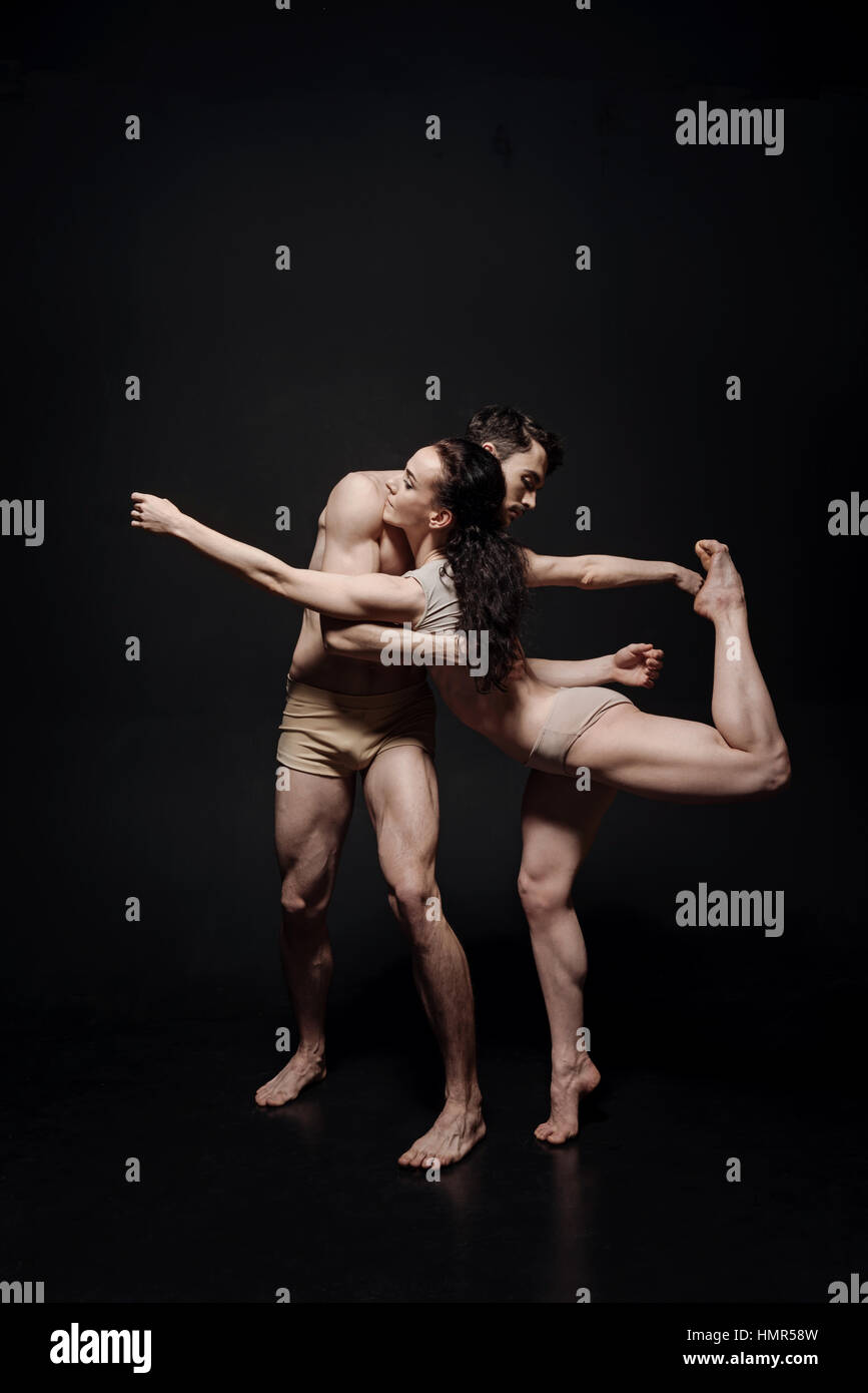 Creative young dance couple taking part in the art performance - Stock Image