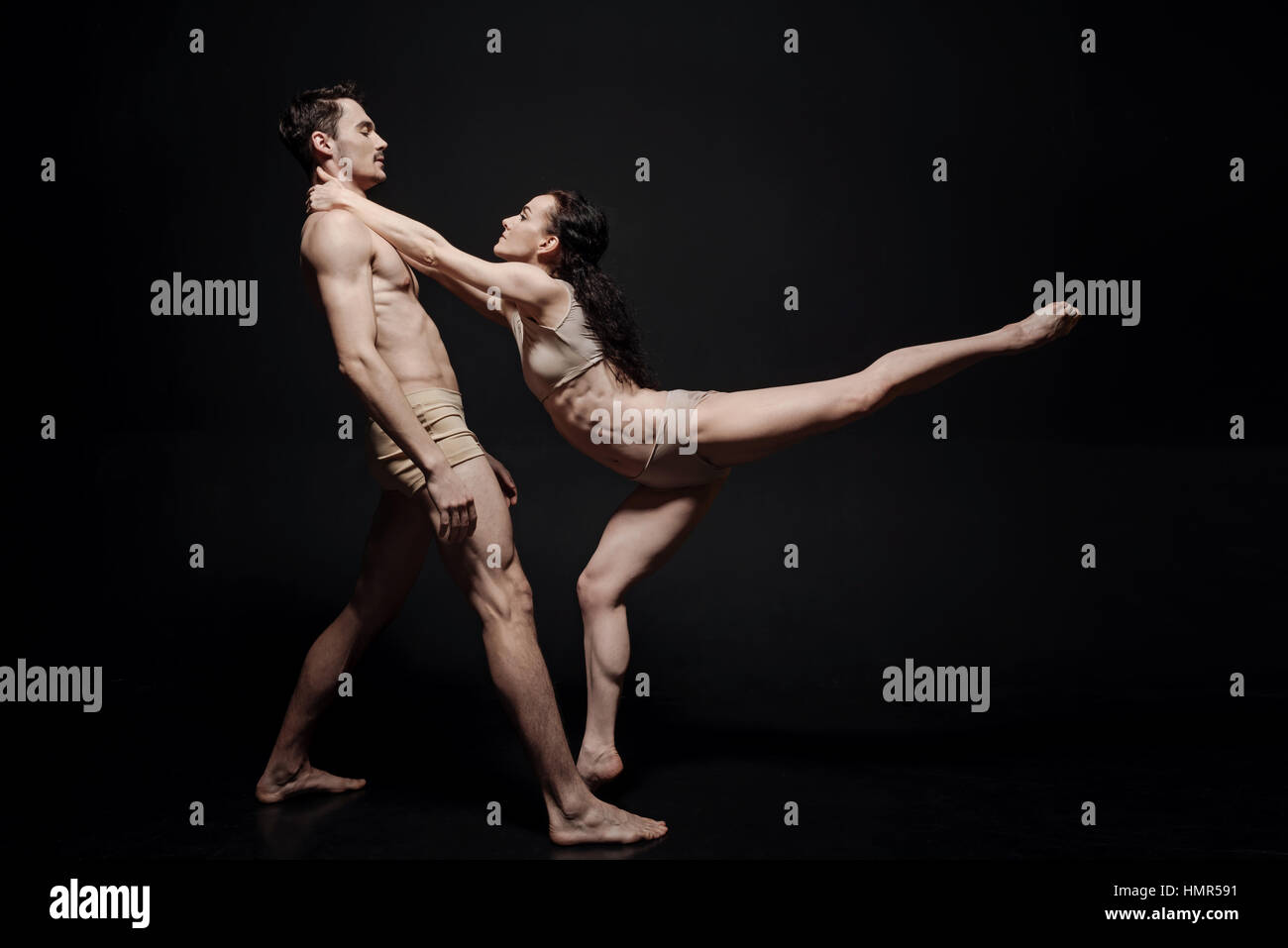 Beautiful young dance couple taking part in the art performance - Stock Image