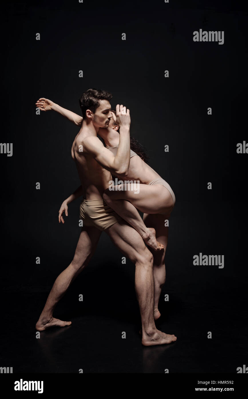 Innovational dance couple taking part in the art performance - Stock Image