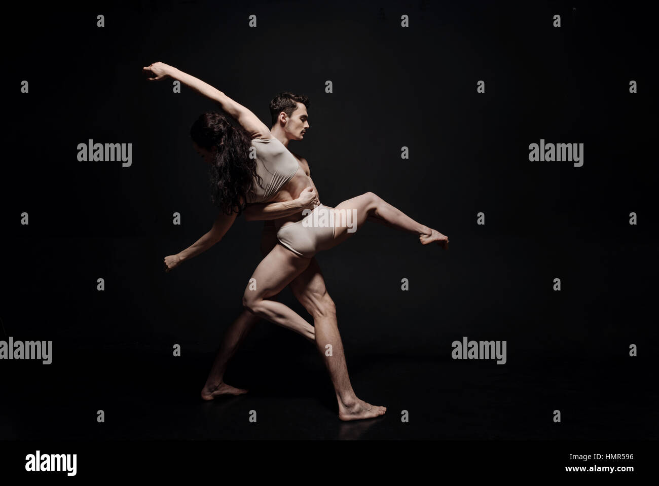 Inventive young dance couple taking part in the art performance - Stock Image