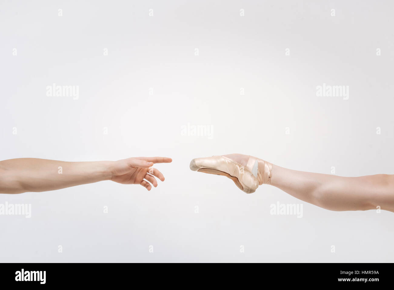 Leg and arm against white background - Stock Image