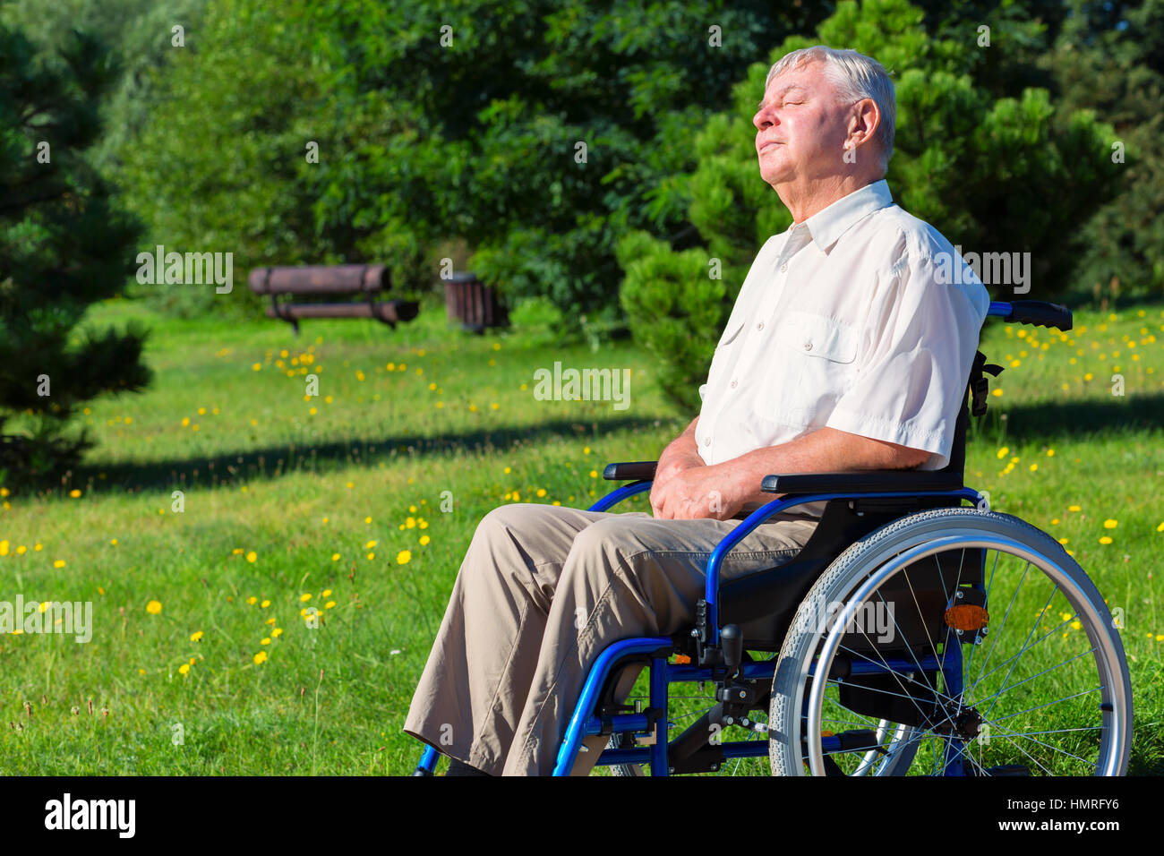 Image of: Electric Power Old Man On Wheelchair Enjoying Sunlight In The Park Whats On Xiamen Old Man On Wheelchair Enjoying Sunlight In The Park Stock Photo