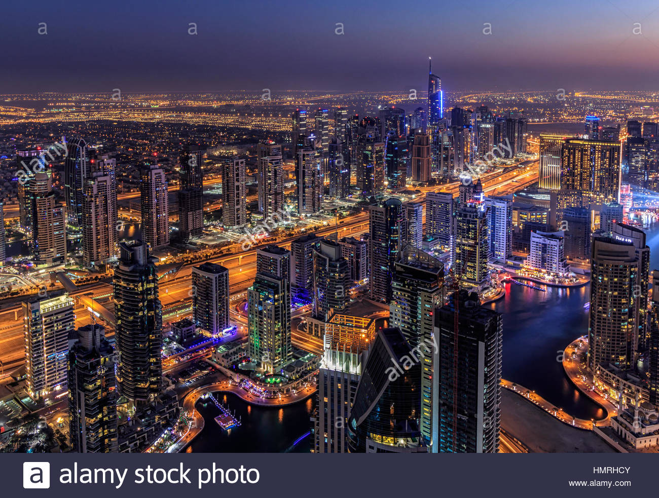 A view of Dubai Marina at night from the rooftop of Cayan Tower - Stock Image