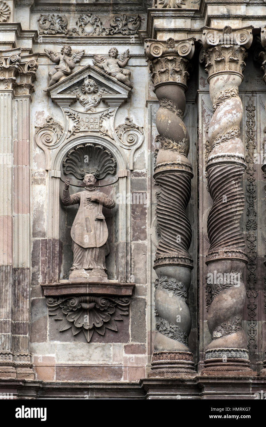 Stone carvings at the façade of the church La Compañia de Jesús made of Ecuadorian andesite stone, Quito, Ecuado Stock Photo
