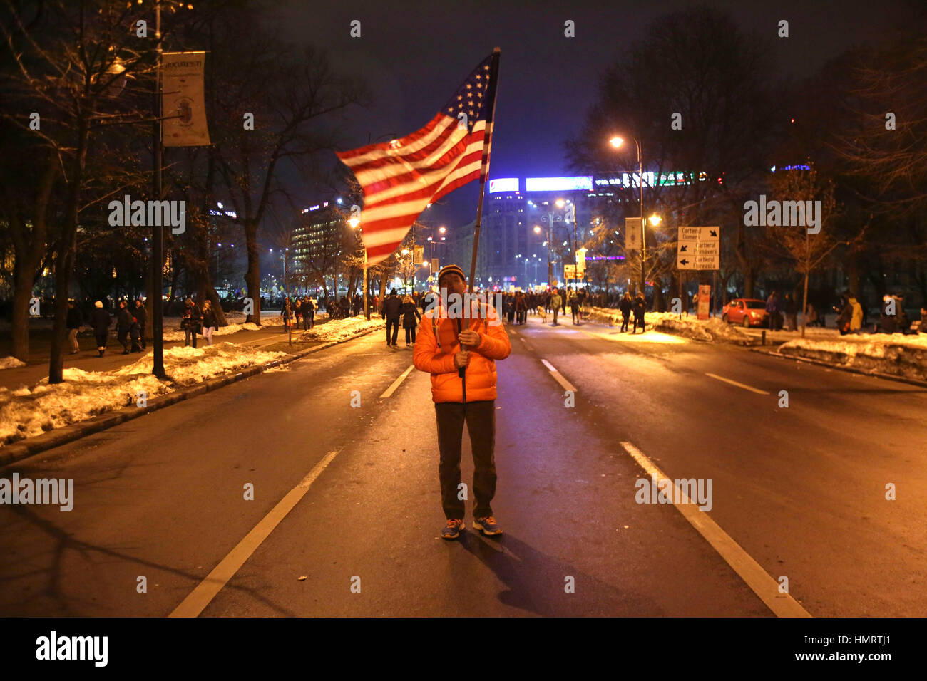 Bucharest, Romania. 4th Feb, 2017.  Man waving american flag during the protest in front of Romanian Government - Stock Image