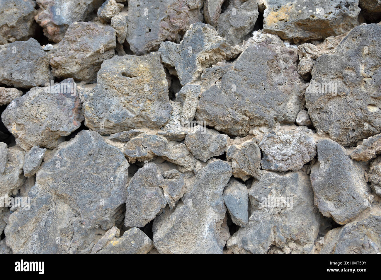 Close up of a wall made of lava stone, picture from Puerto de la cruz Tenerife. - Stock Image