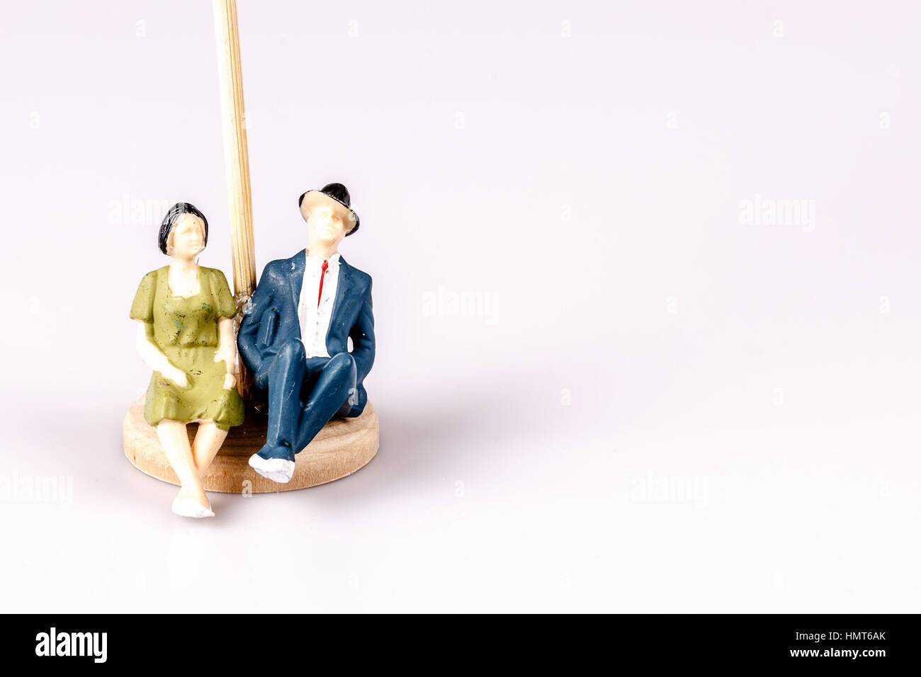 toy models of old couple on white - Stock Image