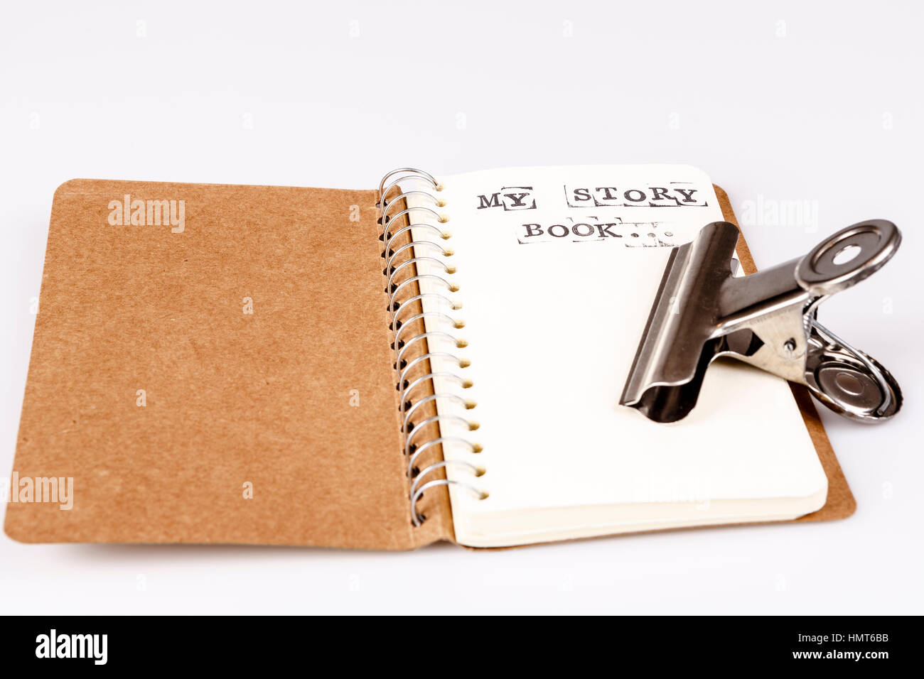 open empty diary or story book on white - Stock Image