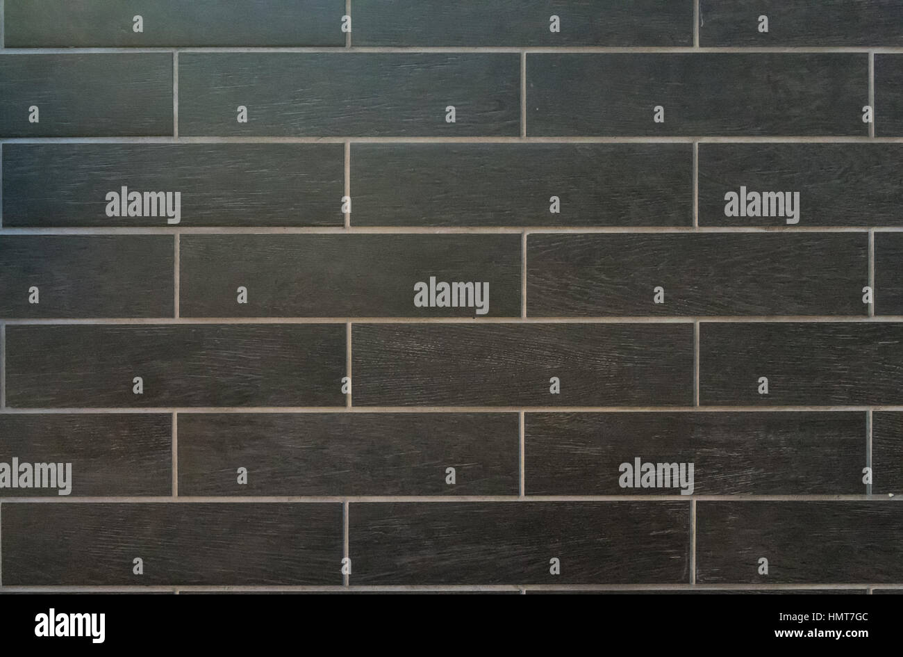 Long Gray Tiles with White Grout and a wood grain finish Stock Photo ...