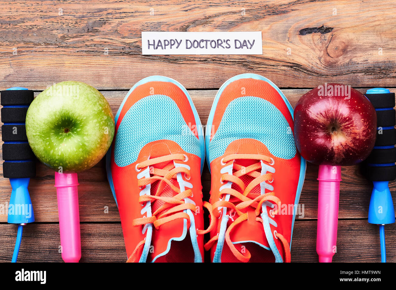 Apples, gumshoes and jump rope. - Stock Image