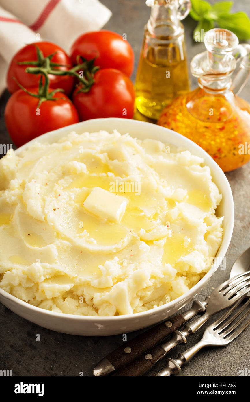 Mashed potatoes with butter in big bowl - Stock Image