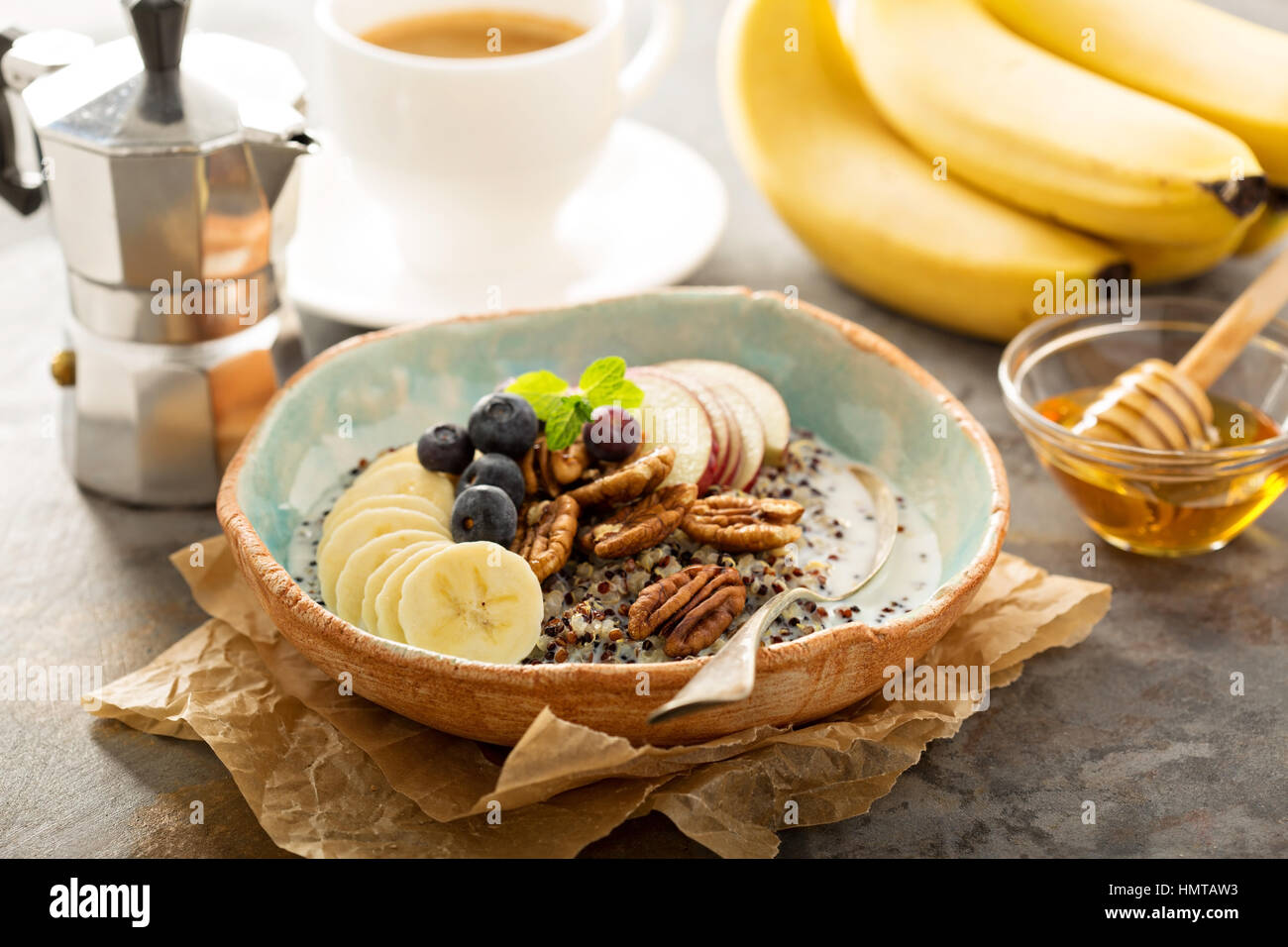 Quinoa porridge with banana, blueberry and pecan nuts for breakfast - Stock Image