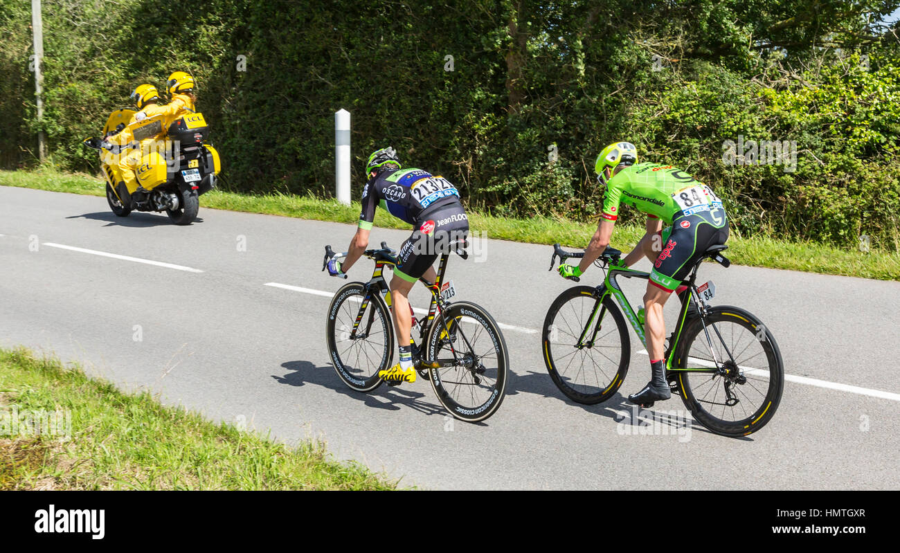 Quineville,France- July 2, 2016: The cyclists Anthony Delaplace of Fortuneo-Vital Concept Team and Alex Howes of - Stock Image