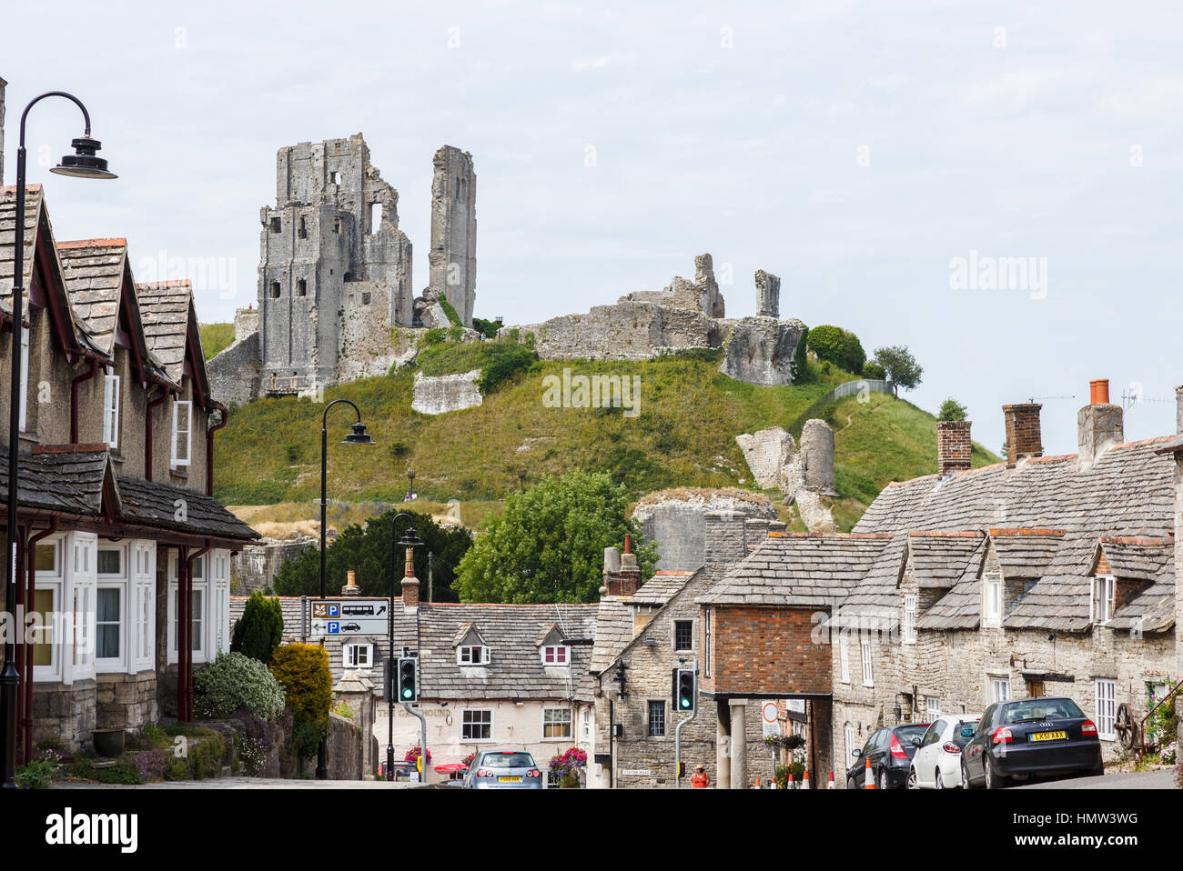 The hilltop ruins of Corfe Castle, survivor of the English Civil War, in the village of Corfe, Dorset, south-west - Stock Image