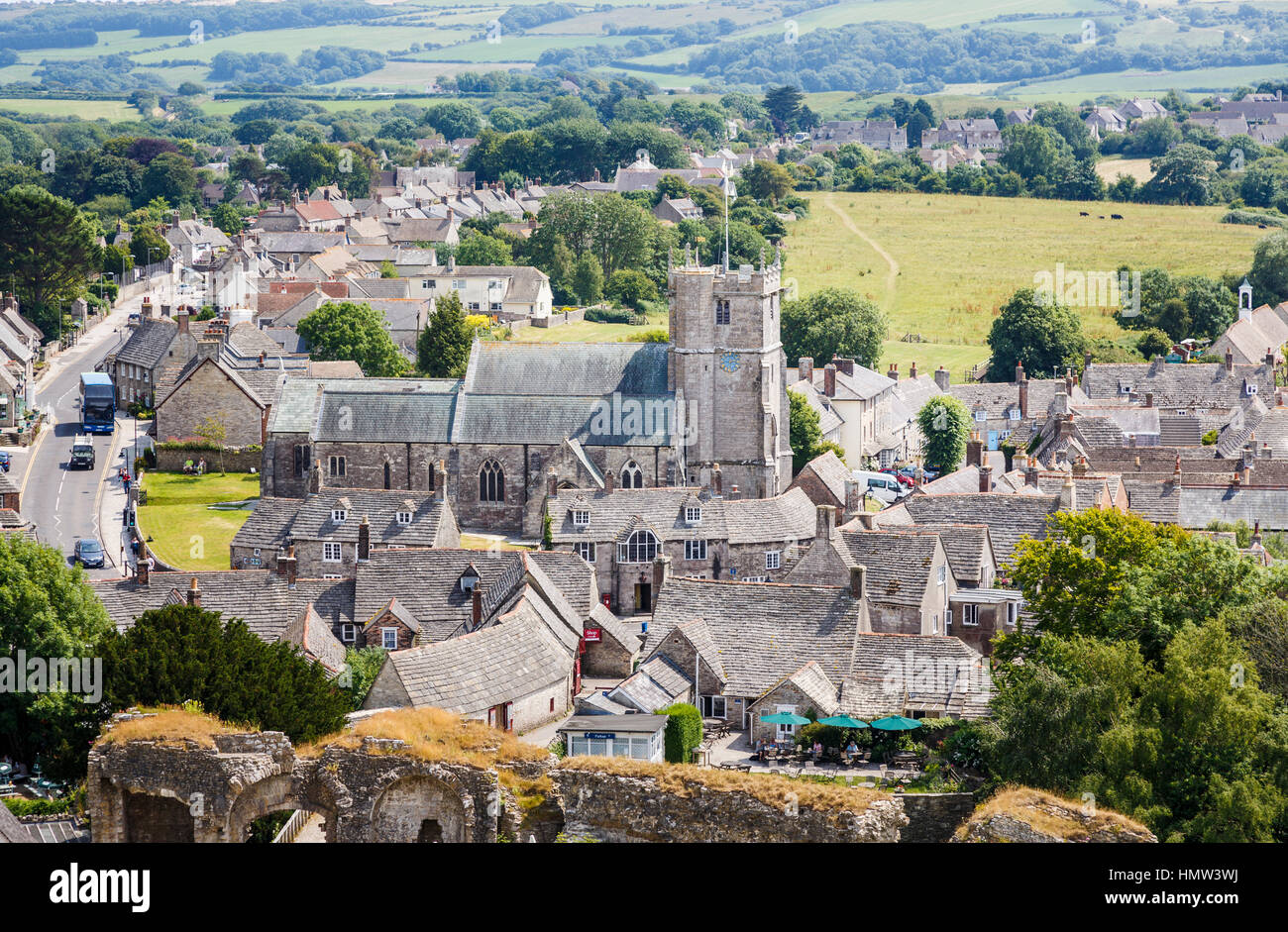 Rooftop view over the pretty, unspoiled village of Corfe Castle, Dorset, south-west England with its slate stone - Stock Image