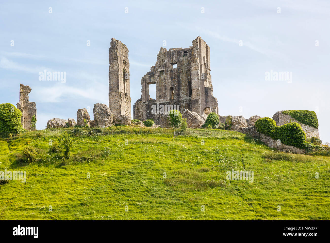 View of the the hilltop ruins of Corfe Castle, survivor of the English Civil War, in Corfe, Dorset, south-west England - Stock Image