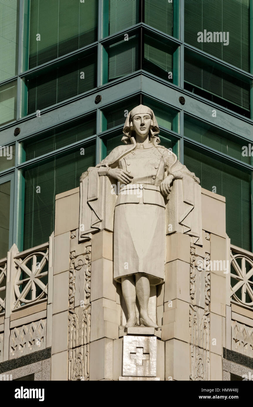 Terra cotta sculpture of nursing sister in First World War uniform decorating Cathedral Place tower in downtown - Stock Image