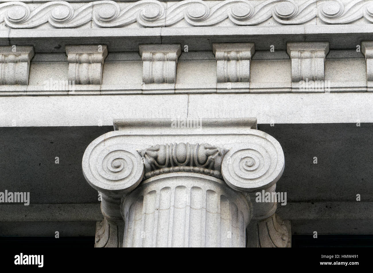 Detail of Ionic column capital and cornice of the Birks Building in downtown  Vancouver, British Columbia, Canada - Stock Image