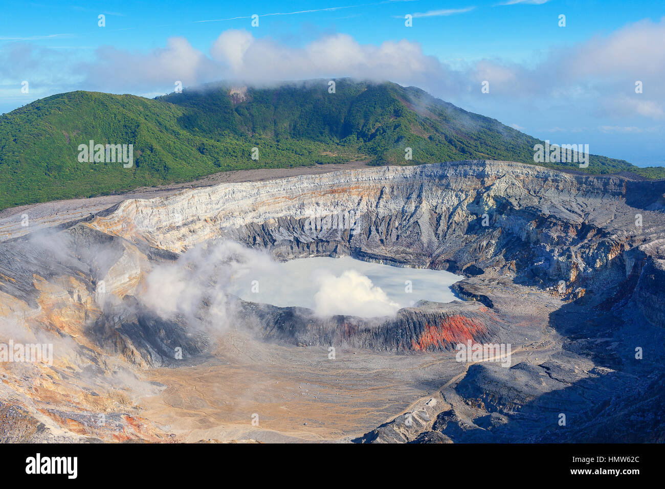 Caldera with crater lake, steam rising from Poas Volcano, Poas Volcano National Park, Costa Rica - Stock Image