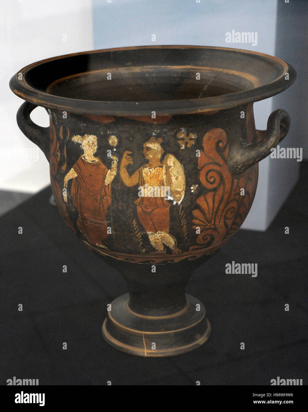 Campanian red figure krater depicting a warrior with helmet, shield, cuirass and spear looking a female figure with Stock Photo