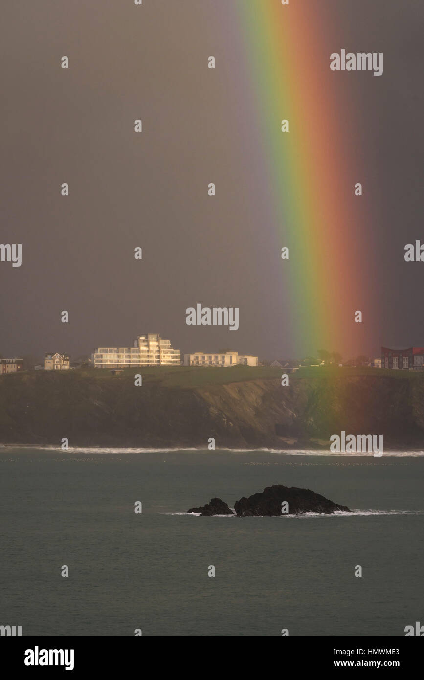 A closeup view of a rainbow over the coast of Newquay, Cornwall, England. UK weather. - Stock Image