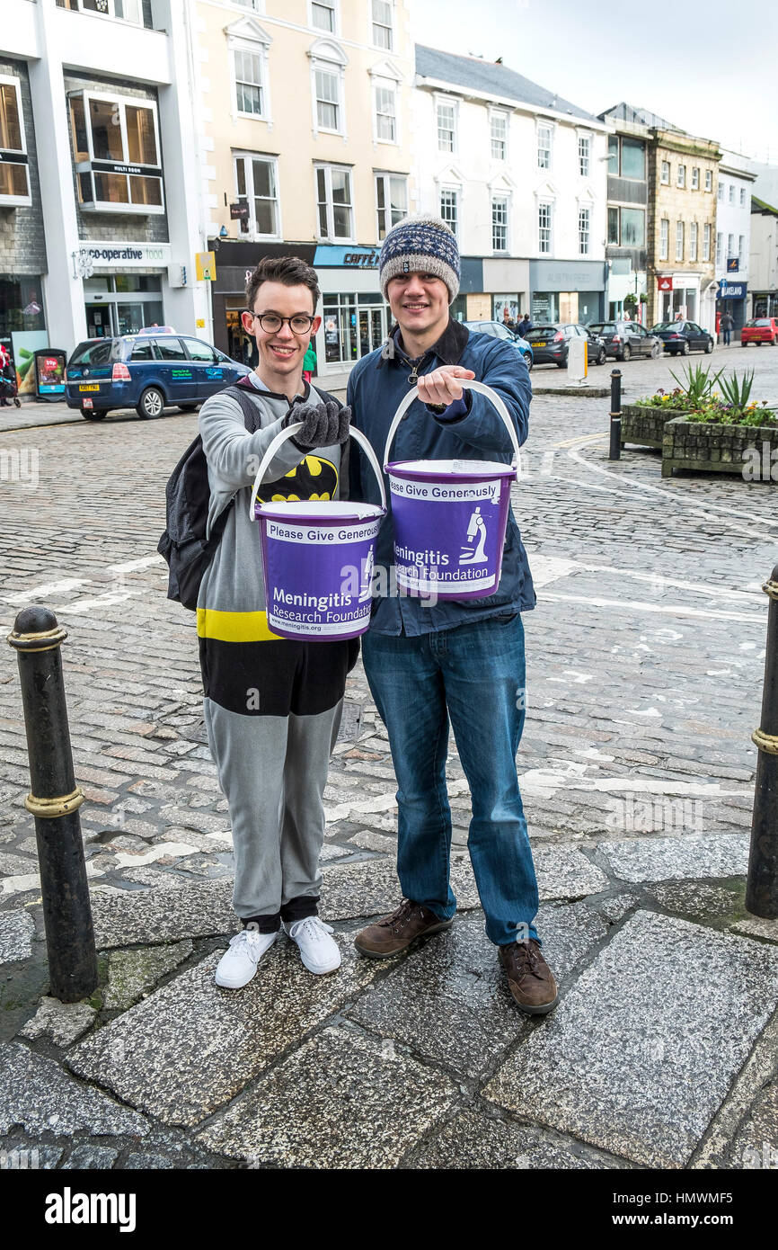 Two volunteers collecting charity donations for the Meningitis Research Foundation in Truro City centre, Cornwall. - Stock Image
