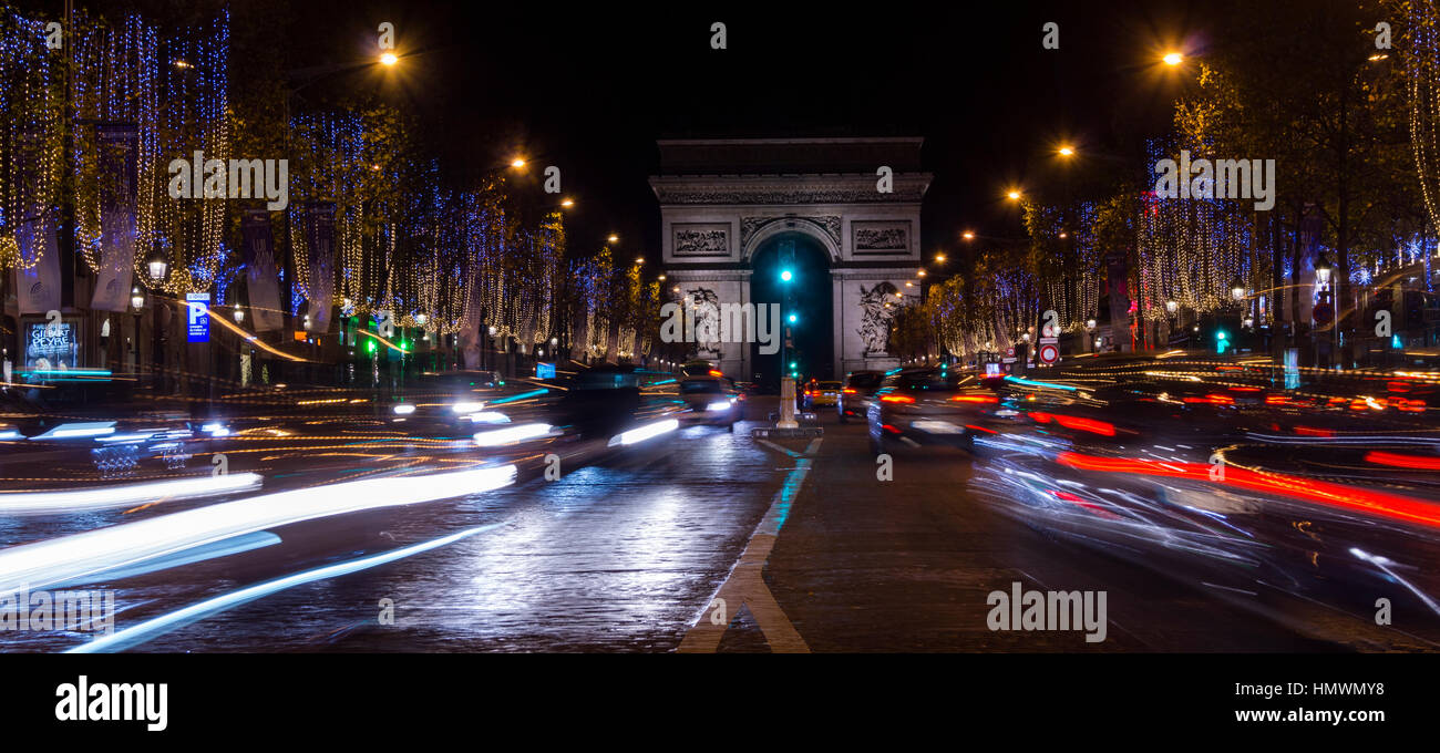 Champs Elysees in Paris illuminated for Christmas and Triumphal Arch in background - Stock Image