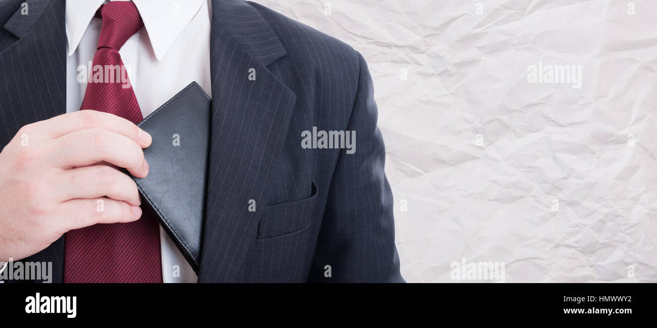 Business manager taking his leather wallet out of his pocket to pay something with advertising area - Stock Image