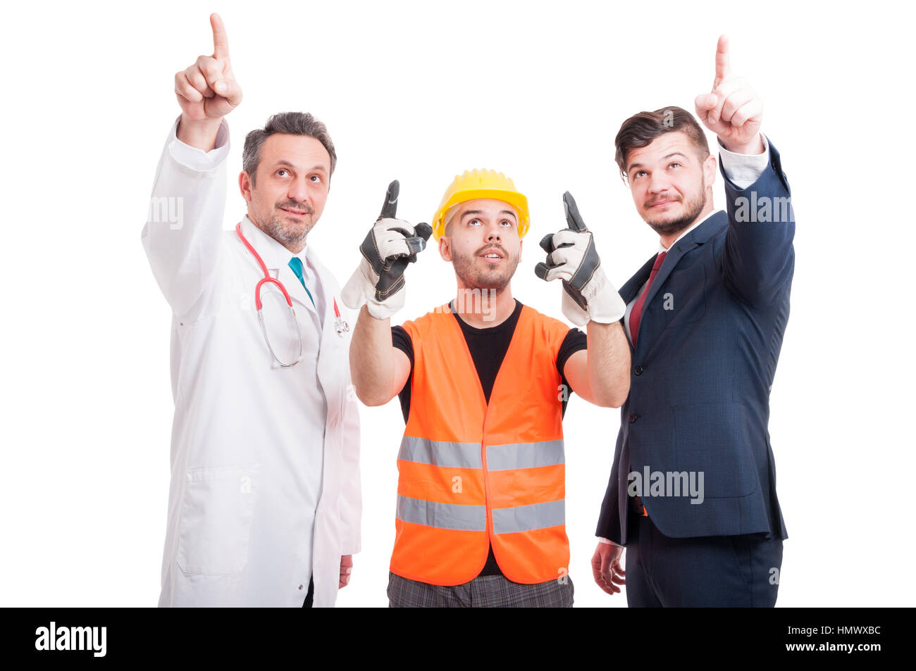 Constructor, businessman, and doctor or medic pointing all fingers up and looking at something isolated on white Stock Photo