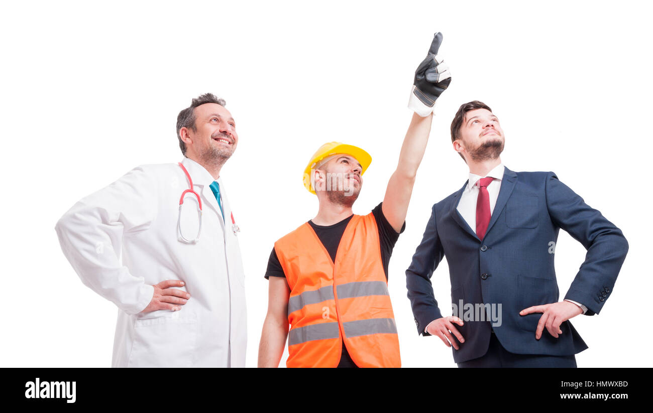 Low angle shot of group of people with different professional occupations indicate something on white background Stock Photo