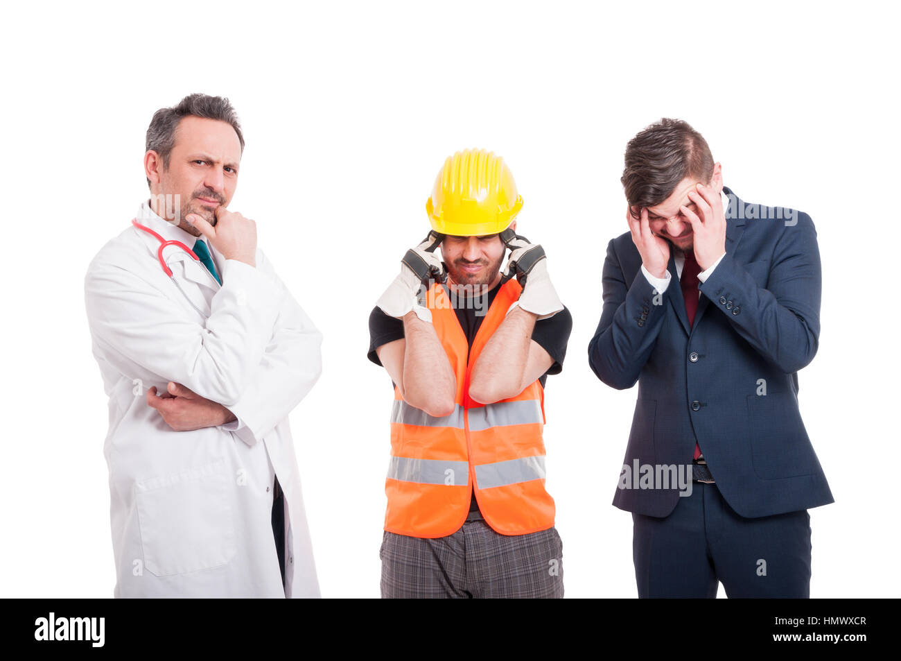 Pensive doctor near stressed engineer and businessman with headache or migraine on white studio background Stock Photo