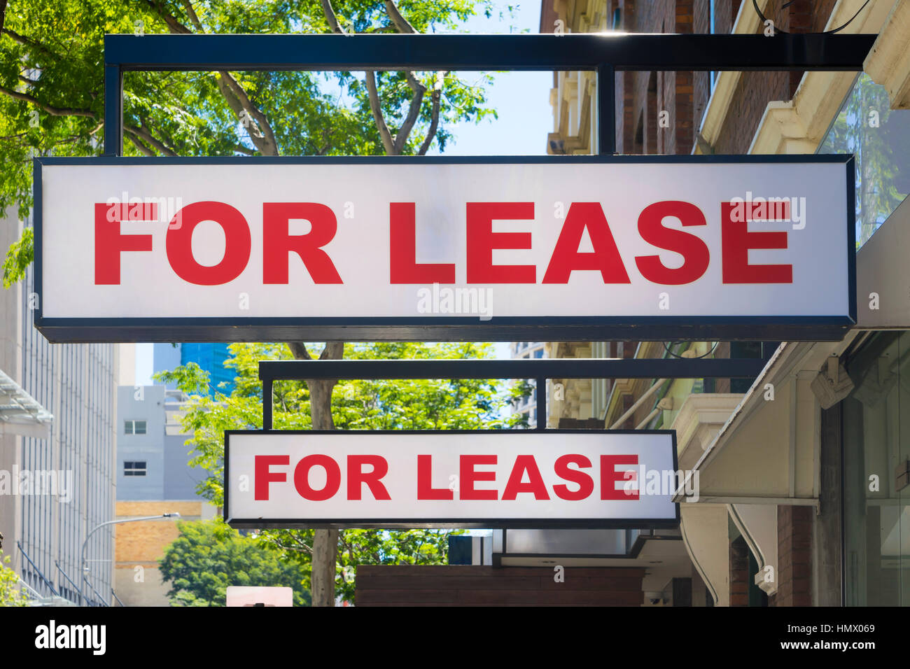 For Lease signs on display outside buildings - Stock Image